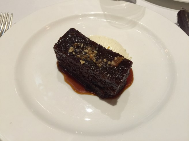 Sticky toffee pudding with caramelized walnuts and creme fraiche
