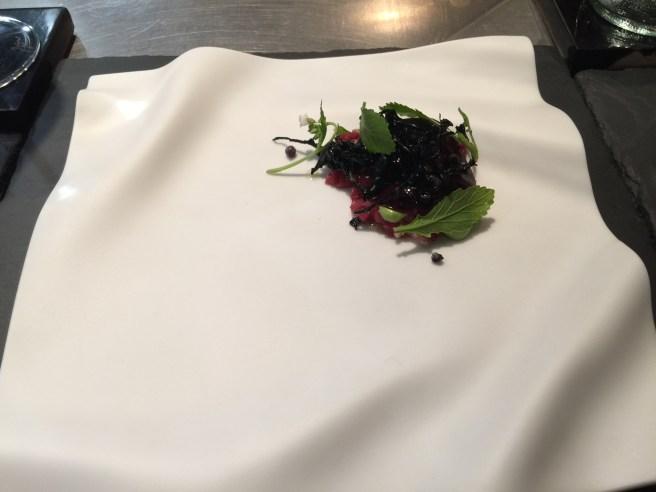Black trumpet with raw venison, elderberry and arugula