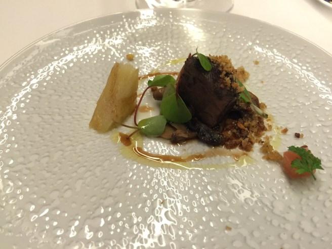 Amuse: braised black pork cheek with mushrooms and potato gratin
