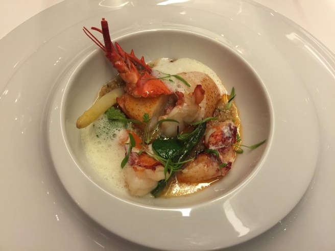 Roasted lobster with barley risotto, sausage adn saffron emulsion