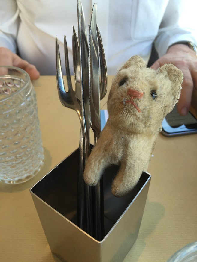 Frankie checked out the table's flatware holder