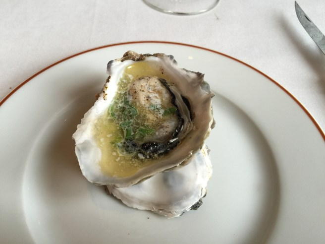Oyster served warm with salt and herbs. Nice