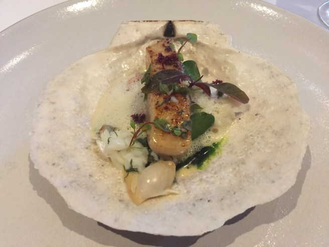 Live sea scallop with coquillage, ginger, shiso