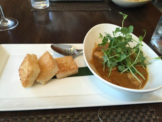 Chicken rendang with malay spices, red chile lemongrass rempah, coconut cream