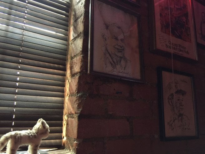 Frankie looked over some of the portraits on the walls