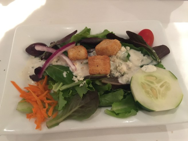 Mixed green salad with blue cheese dressing