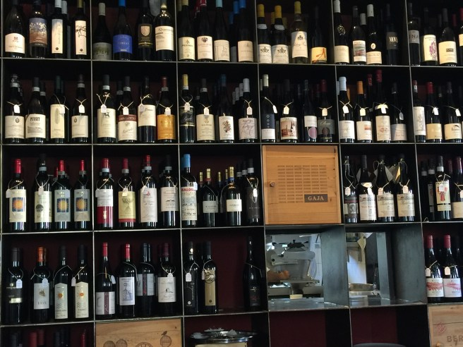wine wall with holes to kitchen