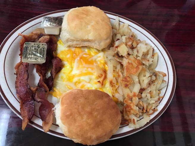 soft scrambled eggs with cheese, hashbrowns, biscuits and bacon