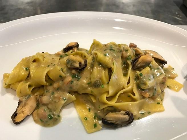 Tagliatelle alle Cozze: fresh pasta, crisp guanciale, sicilian caper, seasonal mushrooms, salt spring island mussels