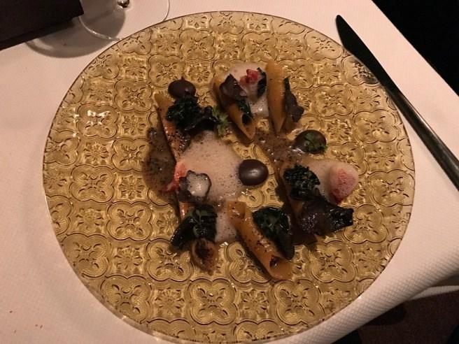 Garganelli with lobster, black cabbage and black trumpet mushrooms