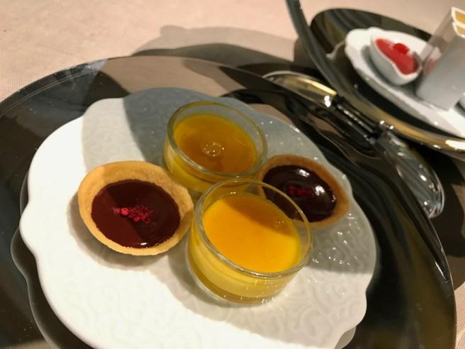 chocolate and raspberry tart;  creme brulée