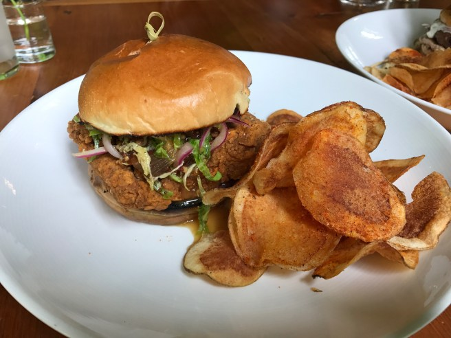 Fish Sandwich with grilled bread, brussel sprout slaw, warm bacon vinaigrette, blueberry mostarda