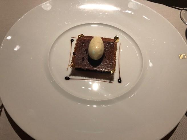 Contemporary dark chocolate tart with bourbon vanilla ice cream