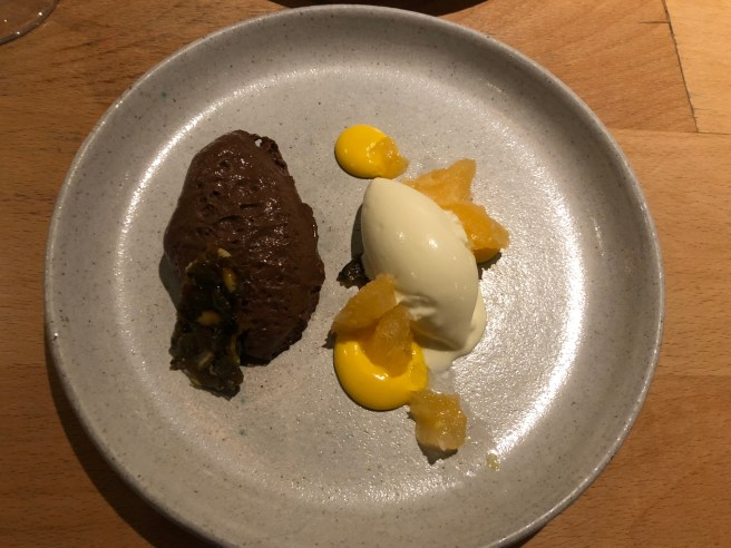 Chocolate mousse, clementine leaf ice cream and pumpkin seeds
