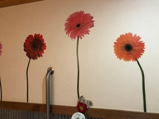 Frankie liked the flower wallpaper