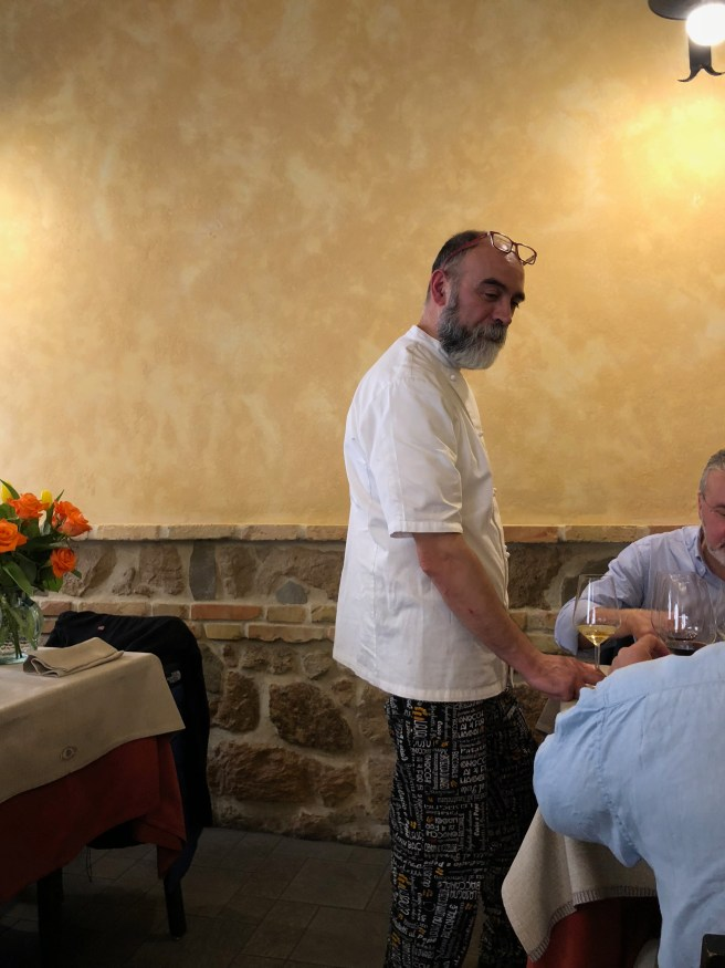 Chef Giuseppe Ruzzeto visits with guests