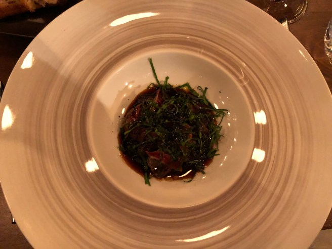 Black rice with morel, crunchy speck and wild garlic, poultry sauce