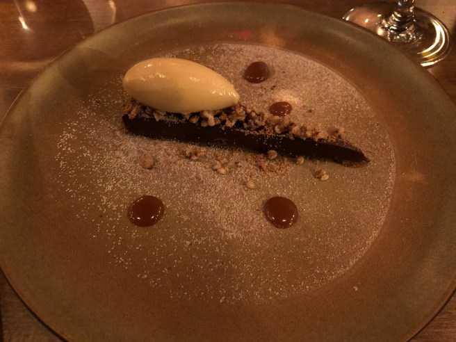 Black chocolate tart and dolce de leche ice cream, bukwheat crisp