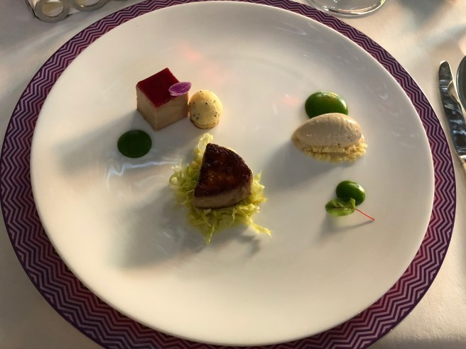 Goose liver structure with peppered strawberries, peas and basil