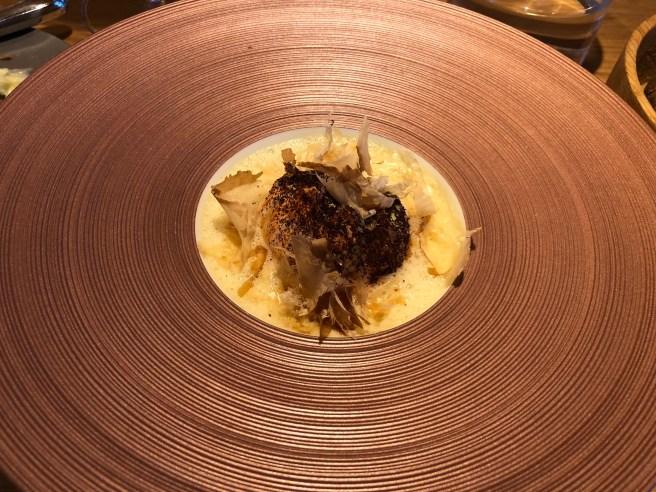 Langoustine poached in duct fat, Dashi albufera, coffee, Katsuobushi