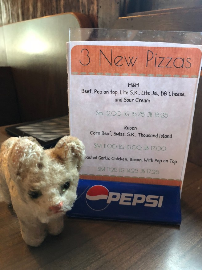 Frankie saw a sign about new pizzas
