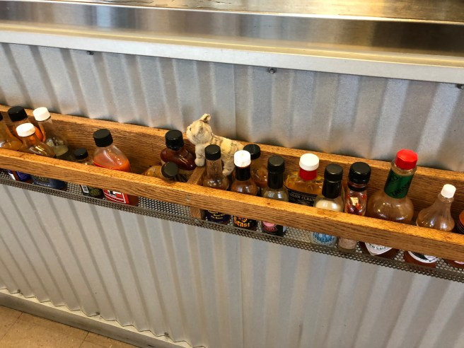 Frankie and the hot sauce rack