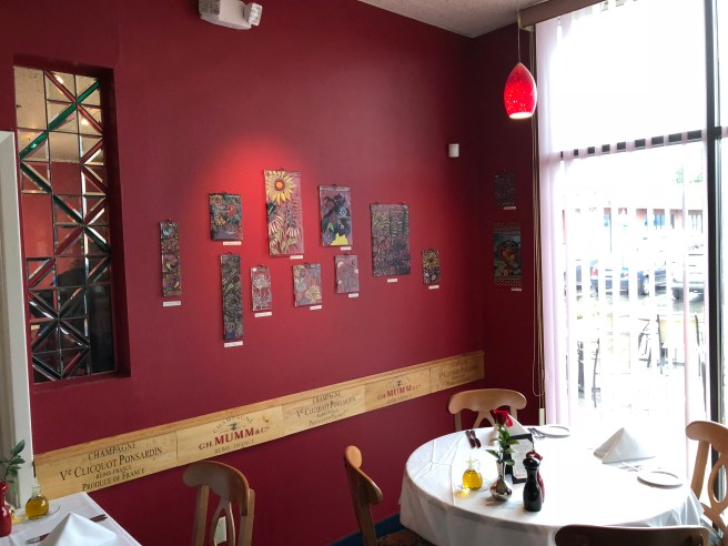 walls filled with art and wine stuff