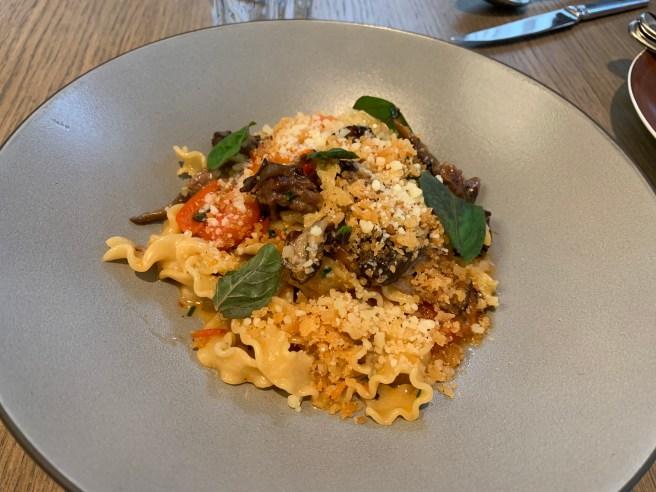 Slow Roasted Short Rib Mafaldine with maitake mushrooms, smoked tomato butter, parmesan breadcrumbs and parsley