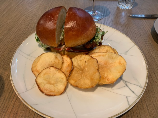 the Firebird Chicken Sandwich with lettuce, tomato, pickle, mayonnaise and fried-onion ranch served with chips