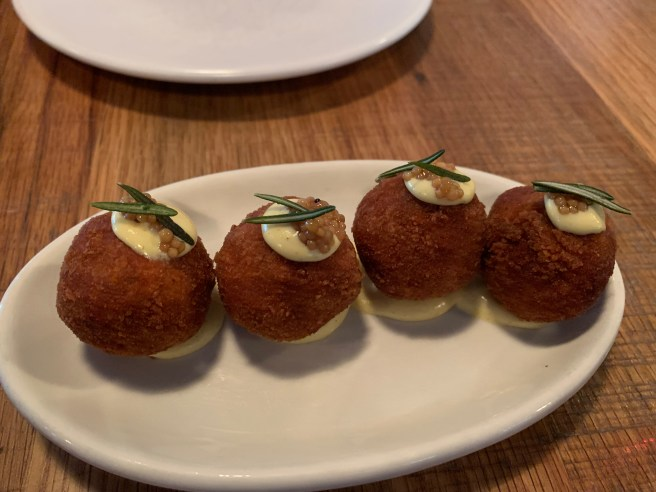 Olive Ascolane - fried stuffed olives, goat cheese, sausage, Dijon aioli, rosemary, Miele Thun honey