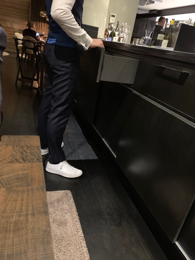 all the staff wore white sneakers