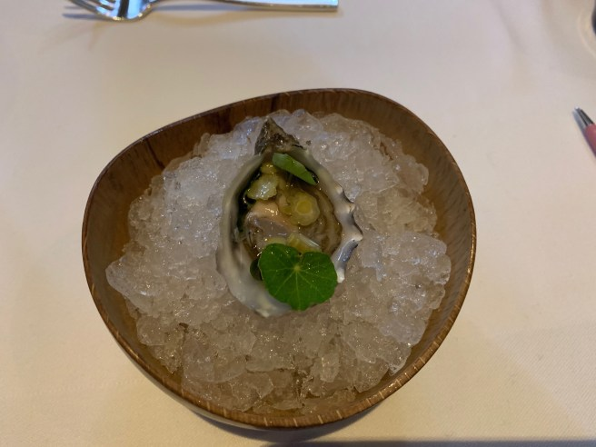Pacific gold oyster with nasturtium and California capers