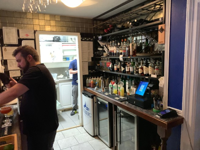 bar leading to kitchen