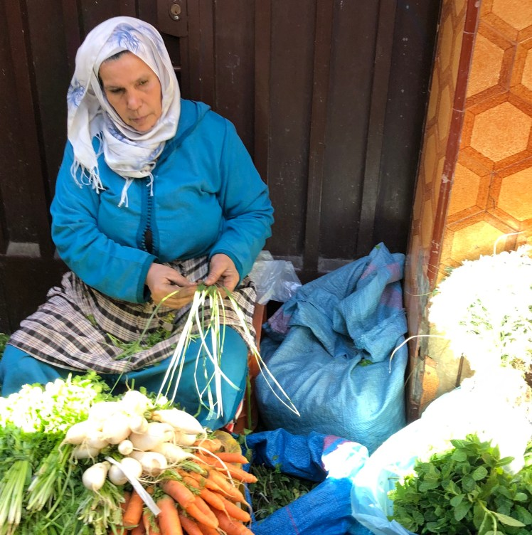 Morooccan woman selling vegetables in Medina of Tangier