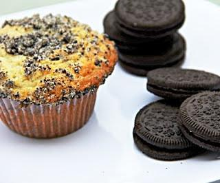 oreo muffin with stacks of oreo on a white plate