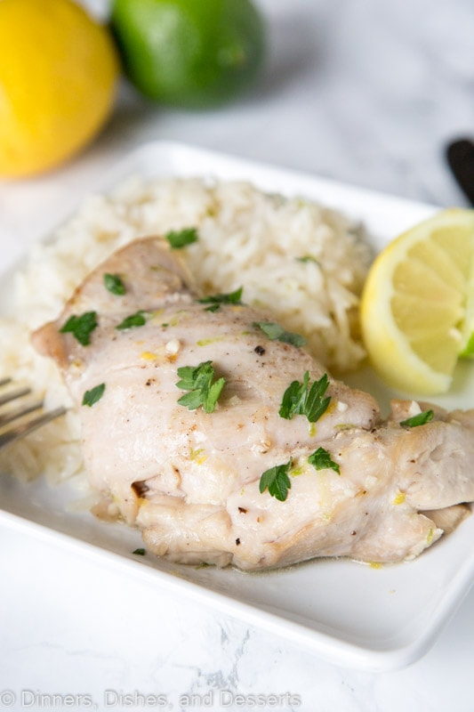 Citrus Garlic Chicken with Coconut Lime Rice - Chicken dinner made with tons of citrus for a bright and fresh dinner. Plus rice cooked in coconut milk and toss with lime for the perfect side dish.