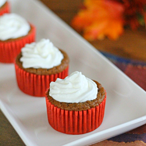 Pumpkin Pie Cupcakes on white plate with whipped cream on top
