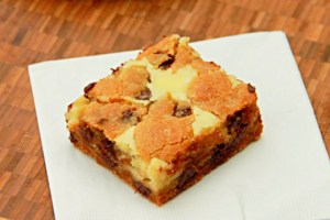 Chocolate Chip Cheesecake Cookie Bars on cutting board