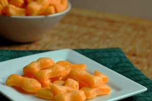 Homemade Goldfish Crackers on white plate with green napkin