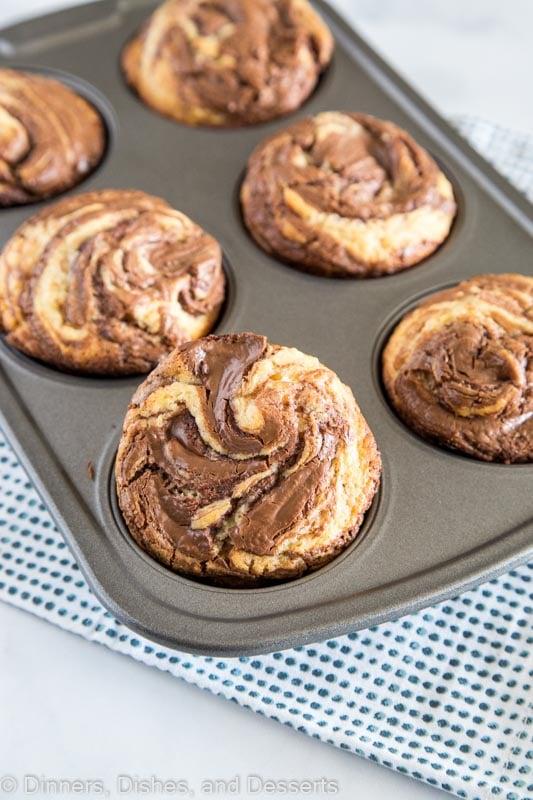 nutella muffins in a muffin tin