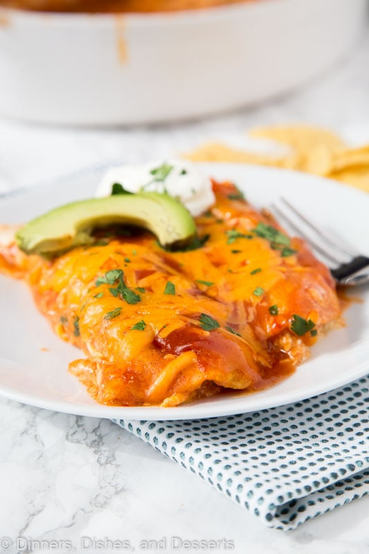 A plate of food on a table, with Enchilada and Cream