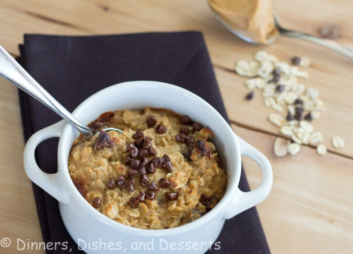 Cookie Dough Baked Oatmeal in white bowl with spoon on black napkin