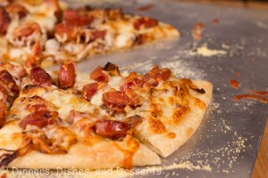 Caramleized Onion and Andouille Pizza on baking sheet