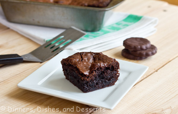 Fudgy Brownies with thin mint cookies in each bite on white plate