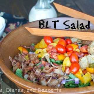 A bowl of food on a table, with Dinner and Salad