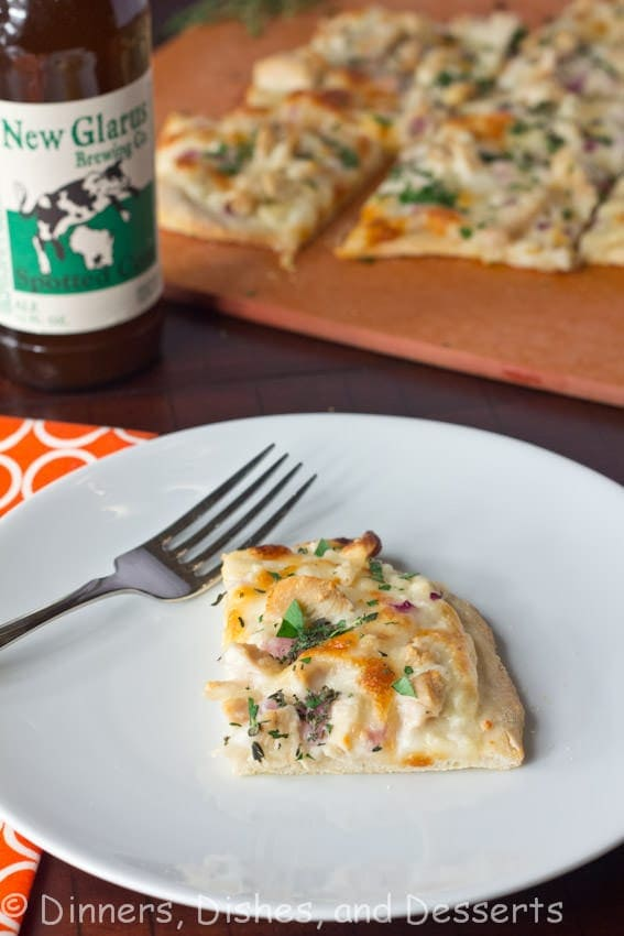 Roasted Garlic, Chicken & Herb White Pizza - Roasted garlic sauce topped with chicken, red onions, and herbs. A great white pizza that will rival any pizza out there!