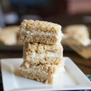 Pumpkin Cake Rice Krispie Treats - Pumpkin spiced rice krispie treats with a layer of cream cheese frosting.