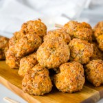 Cheesy Sausage Meatballs - A classic comfort food appetizer that is perfect for your holiday party! So easy to make, ready in minutes, and they disappear every time.