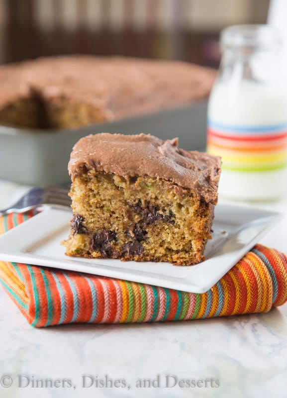 zucchini chocolate chip cake with nutella buttercream frosting on a plate