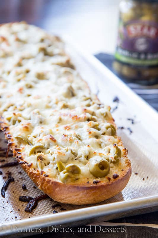 garlic olive cheese bread on a plate